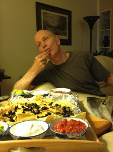 Jinx trying to convince Ray that Nachos are good for dogs!