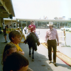 Paul rides Admiral in a parking lot in the early 1970s