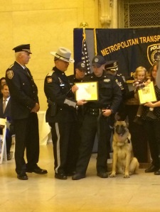 Each handler received a diploma, each canine received a badge, and each family of the dog's namesake received a plaque