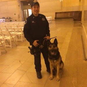 K-9 George and MTA Police Officer Allan Fong after graduation